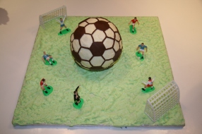 Football Cake - Gooey chocolate on the inside, iced with hexagons cut from sugarpaste