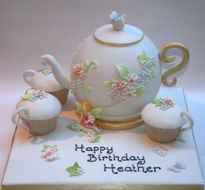 Teapot and fairy with tea cups