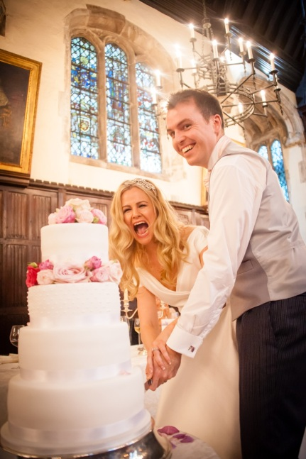 Couple Enjoying their Etoile Wedding Cake At Lincoln's Inn London