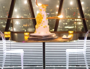 Tumbling yellow rose wedding cake