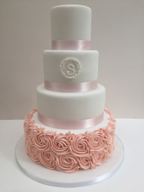 Buttercream rose and monogram wedding cake