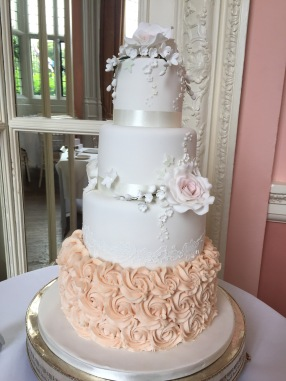 Buttercream and rose wedding cake