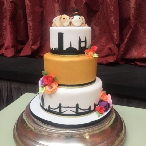 Vibrant Wedding Cake with Silhouette and Bride and Groom Guinea Pigs