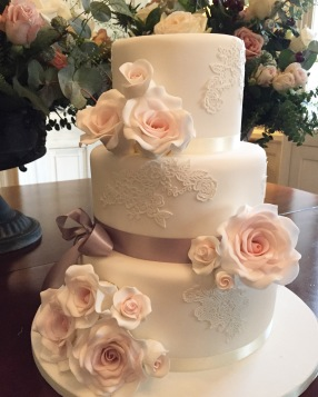 Rose Wedding Cake With Silver Bow